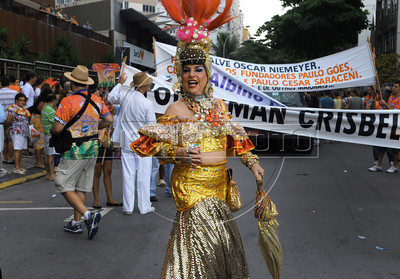A reveler dressed as Carmen Miranda performs during a carnival parade of the traditional Banda de Ipanema in a Ipanema's street, Rio de Janeiro, Brazil, January 26, 2013. Hundreds gathered for the annual 'Band of Ipanema' samba parades through the beachfront, the city's most famous street party of the year. (Austral Foto/Renzo Gostoli)