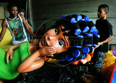 Workers prepare ornaments for a samba school float, Rio de Janeiro, Brazil, January 30. 2013. The float will be used during the carnival parades which begin on February 8. Thousands of people work for more 6 months out of the year preparing for carnival. (Austral Foto/Renzo Gostoli)