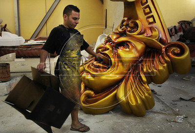 A worker prepares ornaments for a samba school float, Rio de Janeiro, Brazil, January 30. 2013. The float will be used during the carnival parades which begin on February 8. Thousands of people work for more 6 months out of the year preparing for carnival. (Austral Foto/Renzo Gostoli)