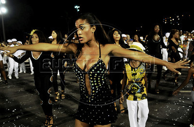 Samba dancer Diana Prado performs during a Sao Clemente samba school's rehearsal at the Sambadrome, Rio de Janeiro, Brazil, January 12, 2013. All week end of January and February the Rio's samba schools train in the Sambadrome for the carnival parade. The 2013 carnival start officially February 8.  (Austral Foto/Renzo Gostoli)