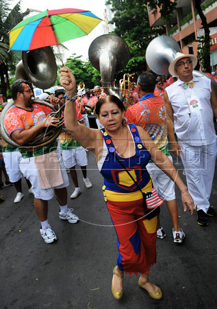 A reveler dances during a carnival parade of the traditional Banda de Ipanema in a Ipanema's street, Rio de Janeiro, Brazil, January 26, 2013. Hundreds gathered for the annual 'Band of Ipanema' samba parades through the beachfront, the city's most famous street party of the year. (Austral Foto/Renzo Gostoli)