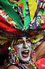 A reveler performs during a carnival parade of the traditional Banda de Ipanema in a Ipanema's street, Rio de Janeiro, Brazil, January 26, 2013. Hundreds gathered for the annual 'Band of Ipanema' samba parades through the beachfront, the city's most famous street party of the year. (Austral Foto/Renzo Gostoli)