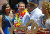 Eduardo Paes, left, Rio de Janeiro's Mayor, gives the key of the city to Milton Junior, center, the Momo King of the Carnival, between the Carnival Queen Shayene Cesario, left, and princess Talita del Castilho, during the carnival opening ceremony, Rio de Janeiro, Brazil. February 12, 2010. The event officially kicks off the 2010 carnival week in Rio. (Austral Foto/Renzo Gostoli)