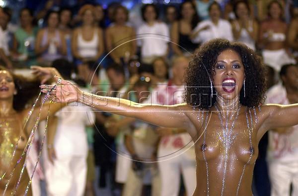 Brazilian model Valeria Valena performs for the Salgueiro Samba School during carnival in Rio de Janeiro in 2001.(Australfoto/Douglas Engle)