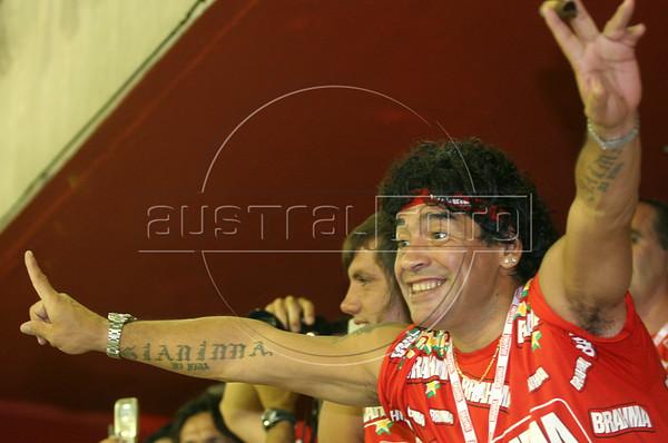 "Argentine football star Diego Maradona cheers during the Caprichosos de Pilares samba school parade in the  ""Sambadrome,"" a stadium built for samba parades, in  Rio de Janeiro, early Feb. 27, 2006.(AustralFoto/Douglas Engle)"