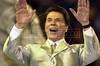 Brazilian TV personality Silvio Santos performs for the Tradiao Samba School during carnival in Rio de Janeiro in 2001.(Australfoto/Douglas Engle)