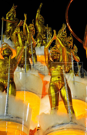 Members of Unidos da Tijuca samba school perform, representing beer, at the Sambadrome during the samba school parade, Rio de Janeiro, Brazil, February 9, 2013. The Unidos da Tijuca Samba school parade pays tribute to Germany during Rio de Janeiro's 2013 carnival celebrations. (Austral Foto/Renzo Gostoli)