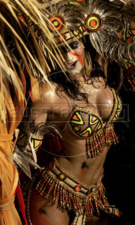 A dancer from the Academicos do Grande Rio samba school performs at the Sambadrome during the samba school parade, Rio de Janeiro, Brazil, March 7, 2011. (Austral Foto/Renzo Gostoli)