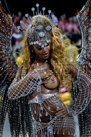 A dancer from the Porto da Pedra samba school performs at the Sambadrome during the samba school parade in Rio de Janeiro, Brazil, Feb. 19, 2007. (Austral Foto/Renzo Gostoli)
