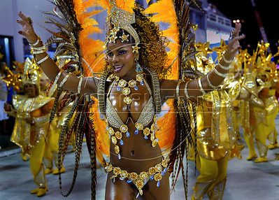 A dancer performs at Sambadrome during samba school parade in Rio de Janeiro, Brazil, Feb. 17, 2007. Carnival is the most popular celebration in Brazil and will run throughout the country until 20 February 2007. (Austral Foto/Renzo Gostoli)