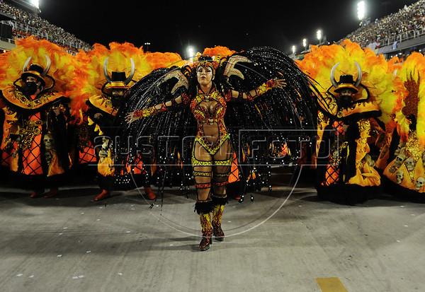 A samba dancer performs at the Sambadrome during theTijuca  samba school parade,  Rio de Janeiro, Brazil, February 10, 2013. The Unidos da Tijuca Samba school parade pays tribute to Germany during Rio de Janeiro's 2013 carnival celebrations. (Austral Foto/Renzo Gostoli)