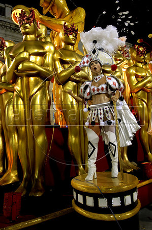 A dancer performs atop of an Academicos do Salgueiro samba school float, decorated with images of Oscar cinema trophy,  down the Sambodrome during the samba school parade, Rio de Janeiro, Brazil, March 5, 2011. (Austral Foto/Renzo Gostoli)
