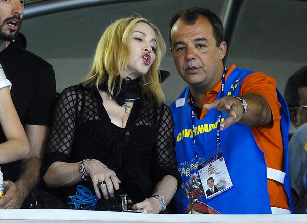 U.S. singer Madonna, left, attend the Carnival parade of samba schools with Rio de Janeiro Governor Sergio Cabral, right, at the Sambadrome, Rio de Janeiro, Brazil, February 14, 2010. (Austral Foto/Renzo Gostoli)