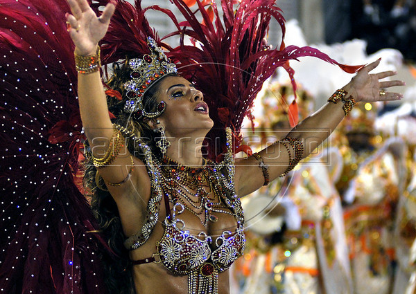 A dancer from Estacio de Sa samba school performs at the Sambadrome during the samba school parade in Rio de Janeiro, Brazil, February 21, 2009. The Grande Rio Samba school parade pays tribute to France during Rio de Janeiro's 2009 carnival celebrations. (Austral Foto/Renzo Gostoli)
