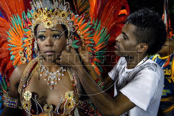 The drum queen of the Renascer de Jacarepagua samba school prepares to perform at the Sambadrome during the samba school parade, Rio de Janeiro, Brazil, March 5, 2011. (Austral Foto/Renzo Gostoli)