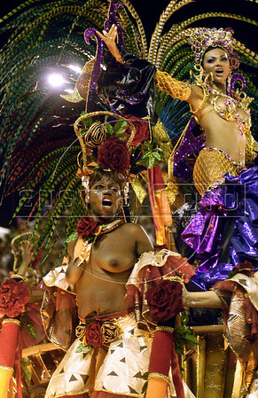 Prostitutes of non-profit organization Davida performs in a float during the parade of Caprichosos de Pilares samba school at the sambodrome in Rio de Janeiro,  Brazil, Feb. 27, 2006.  Davida, which its founders claim works towards legalizing prostitution, helps prostitutes defend themselves against prejudice and educates them on sexually-transmitted diseases. (Austral Foto/Renzo Gostoli)