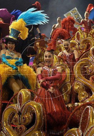 Dancers from french cabaret Moulin Rouge perform atop an Academicos do Grande Rio samba school float down the Sambodrome on the first night of the Carnival samba school parade, Rio de Janeiro, Brazil, February 22, 2009. (Austral Foto/Renzo Gostoli)