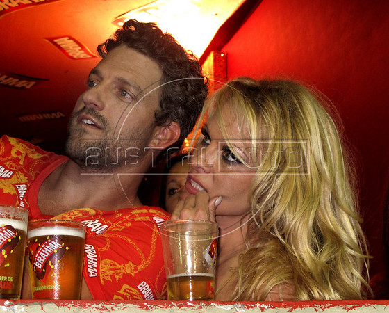 Canadian-American actress Pamela Anderson sits with a friend as they watch the annual Carnival parade at Sambadrome, Rio de Janeiro, Brazil, March 6, 2011. (Austral Foto/Renzo Gostoli)