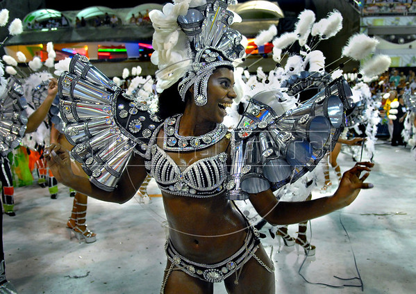 A dancer performs at the Sambadrome during the samba school parade in Rio de Janeiro, Brazil, Feb. 17, 2007. Carnival is the most popular celebration in Brazil and will run throughout the country until 20 February 2007. (Austral Foto/Renzo Gostoli)