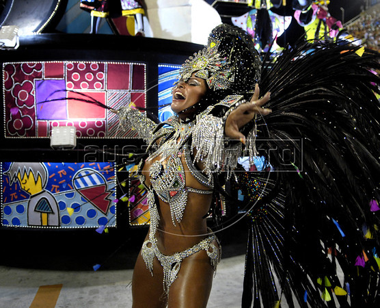 Andrea Martins dancer of Renascer samba school performs at Sambadrome, Rio de Janeiro, Brazil , February 19, 2012. In the back a float decorated with painting of Brazilian artist Romero Britto. (Austral Foto/Renzo Gostoli)