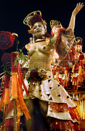 A prostitute of non-profit organization Davida performs in a float during the parade of Caprichosos de Pilares samba school at the sambodrome in Rio de Janeiro,  Brazil, Feb. 27, 2006.  Davida, which its founders claim works towards legalizing prostitution, helps prostitutes defend themselves against prejudice and educates them on sexually-transmitted diseases. (Austral Foto/Renzo Gostoli)