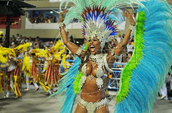 A dancer of Inocentes de Belford Roxo samba school performs at Sambadrome, Rio de Janeiro, Brazil, February 10, 2013. The Inocentes do Belford Roxo Samba school parade pays tribute to South Korea during Rio de Janeiro's 2013 carnival celebrations. (Austral Foto/Renzo Gostoli)