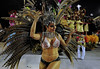 A dancer, with the chest painted, performs at the Sambadrome during the samba school parade,  Rio de Janeiro, Brazil, February 8, 2013. (Austral Foto/Renzo Gostoli)