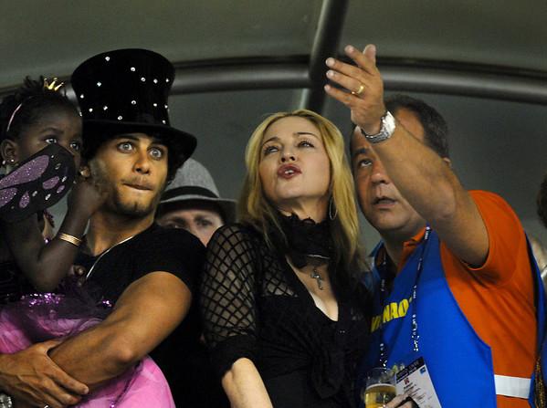 U.S. singer Madonna, center, attend the Carnival parade of samba schools with Rio de Janeiro Governor Sergio Cabral, right, daughter marcy, left,  and boyfriend Jesusu Luz at the Sambadrome, Rio de Janeiro, Brazil, February 14, 2010. (Austral Foto/Renzo Gostoli)