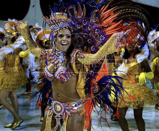 A dancer from the Unidos de Viradouro samba school performs at the Sambadrome during the samba school parade, Rio de Janeiro, Brazil, March 5, 2011. (Austral Foto/Renzo Gostoli)