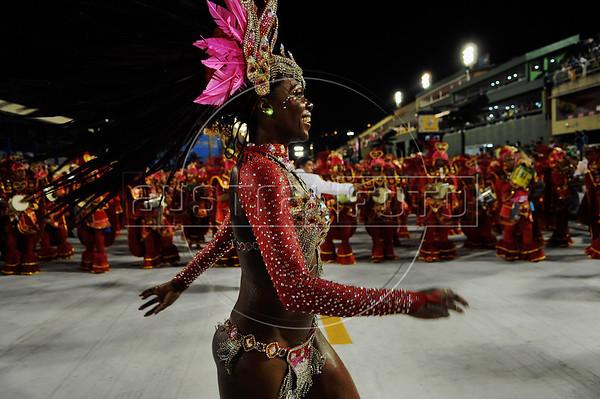 A samba dancerl performs at the Sambadrome during the samba school parade,  Rio de Janeiro, Brazil, February 8, 2013. (Austral Foto/Renzo Gostoli)