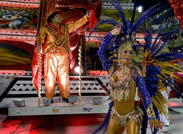 A dancer from Viradouro samba school performs in front of an image of mexican revolutionary Pancho Villa at the Sambadrome during the samba school parade, Rio de Janeiro, Brazil, February 14, 2010. The Viradouro Samba school parade pays tribute to Mexico during Rio de Janeiro's 2010 carnival celebrations. (Austral Foto/Renzo Gostoli)