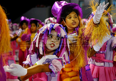 Kids perform at the Sambadrome during the samba school parade in Rio de Janeiro, Brazil, Feb. 17, 2007. Carnival is the most popular celebration in Brazil and will run throughout the country until 20 February 2007. (Austral Foto/Renzo Gostoli)