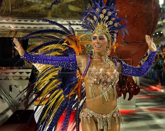 A dancer from Viradouro samba school performs at the Sambadrome during the samba school parade in Rio de Janeiro, Brazil, February 14, 2010. (Austral Foto/Renzo Gostoli)
