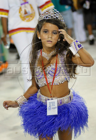 Julia Lira, 7, queen of the drums' section of Viradouro samba school, dances during carnival parades at the Sambadrome,  Rio de Janeiro, February 15, 2010. A family court judge ruled last Wednesday that the 7-year-old is allowed to samba before a crowd of thousands as a Carnival drum corps queen, a coveted role normally reserved for sultry models. (Austral Foto/Renzo Gostoli)