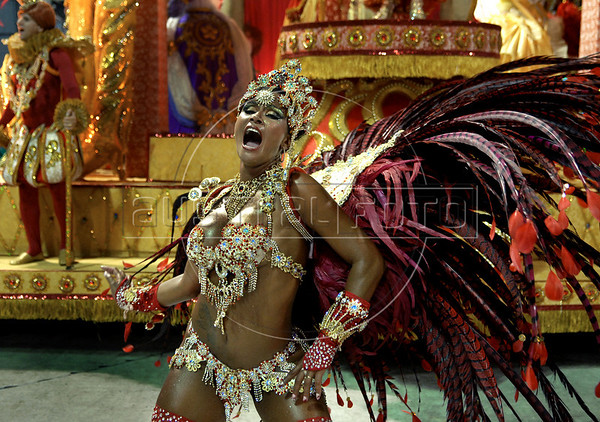 A dancer from Porto da Pedra samba school performs at the Sambadrome during the samba school parade in Rio de Janeiro, Brazil, February 15, 2010. (Austral Foto/Renzo Gostoli)