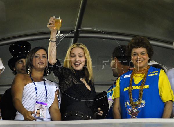 U.S. singer Madonna and Dilma Roussef, right, cabinet chief of Brazil's President Luiz Inacio Lula da Silva, watch the Carnival parade of samba schools at the Sambadrome, Rio de Janeiro, Brazil, February 14, 2010.<br />   (Austral Foto/Renzo Gostoli)