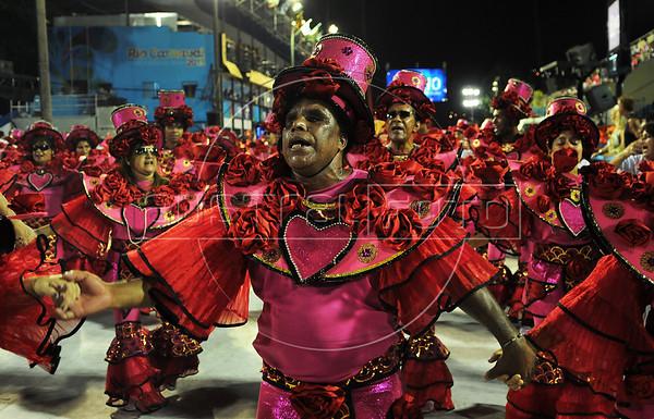 A blind reveler performs at the Sambadrome during the samba school parade,  Rio de Janeiro, Brazil, February 8, 2013. (Austral Foto/Renzo Gostoli)