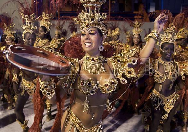 A samba dancer of Renascer samba school performs during the Rio 2005 Carnival parade at the Sambadrome, Rio de Janeiro, Brazil, Feb. 05, 2005. (Renzo Gostoli/Austral Foto)