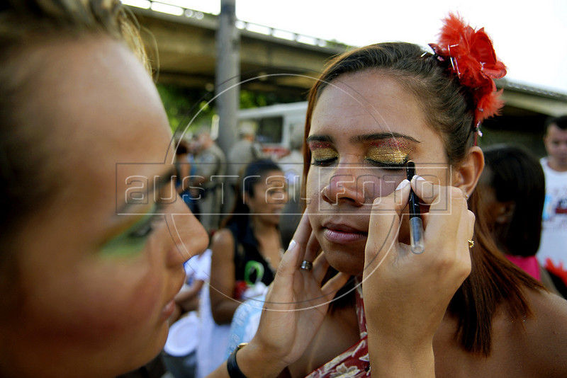 Revelers prepare to participate at a samba school's rehearsal at the Sambadrome, Rio de Janeiro, January 23, 2011. All week end of January and February the Rio's samba schools train in the Sambadrome for the carnival parade. The 2011 carnival start officially March 4. (Austral Foto/Renzo Gostoli)