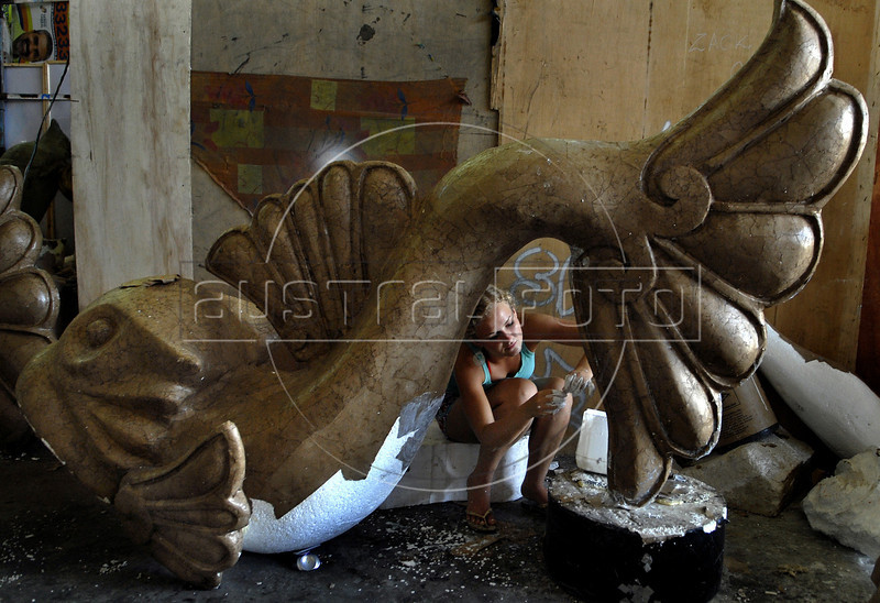 A worker prepares ornaments for a samba school float, Rio de Janeiro, Brazil, February 14, 2011. The float will be used during the carnival parades which begin on March 4, 2011. Thousands of people work for more 6 months out of the year preparing for carnival. (Austral Foto/Renzo Gostoli)