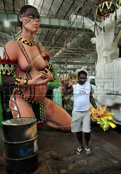 A worker past by a float of a samba school, Rio de Janeiro, Brazil, February 14, 2011. The float will be used during the carnival parades which begin on March 4, 2011. Thousands of people work for more 6 months out of the year preparing for carnival. (Austral Foto/Renzo Gostoli)