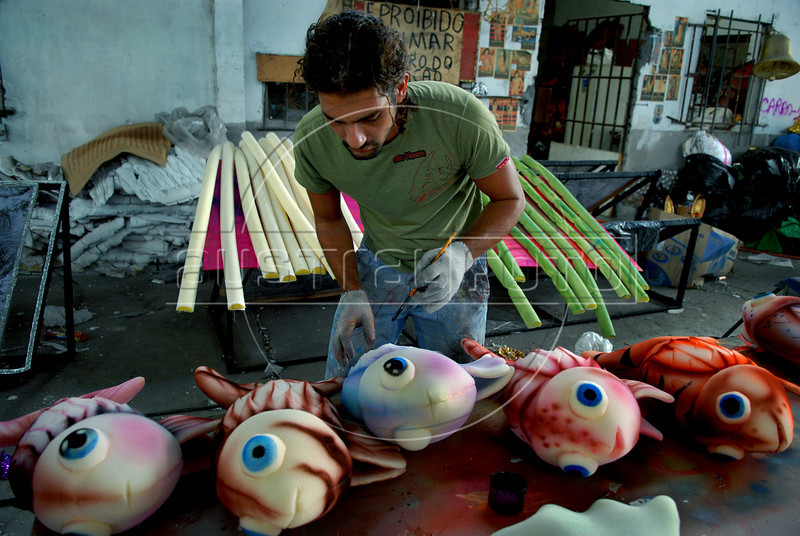 Charles Rocha, 31, artistic painter, prepares a float for a samba school in Rio de Janeiro, Brazil, Jan. 24, 2008. The float will be used during the carnival parades which begin on Feb. 02, 2008. Thousands of people work for 6 months out of the year preparing for carnival. (Austral Foto/Renzo Gostoli)