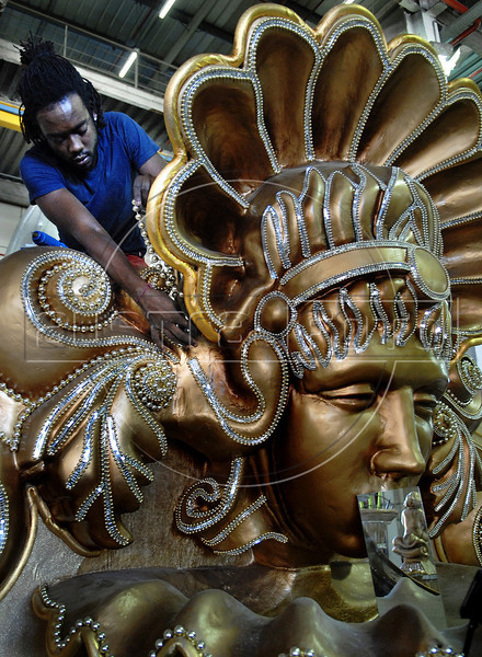 Rafael Bracachio, 23, prepares ornaments of a float of Sao Clemente samba school, Rio de Janeiro, Brazil, February 9, 2011. The float will be used during the carnival parades which begin on March 4, 2011. Thousands of people work for more 6 months out of the year preparing for carnival. (Austral Foto/Renzo Gostoli)