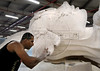 Marcelo Alve, 30, artistic painter, works on a figure for a float of Sao Clemente samba school, Rio de Janeiro, Brazil, February 9, 2011. The float will be used during the carnival parades which begin on March 4, 2011. Thousands of people work for more 6 months out of the year preparing for carnival. (Austral Foto/Renzo Gostoli)