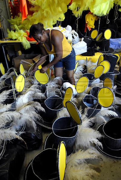 Gloria Maximiano, 56, prepares ornaments for the carnival parade of Sao Clemente samba school, Rio de Janeiro, Brazil, February 9, 2011. The float will be used during the carnival parades which begin on March 4, 2011. Thousands of people work for more 6 months out of the year preparing for carnival. (Austral Foto/Renzo Gostoli)