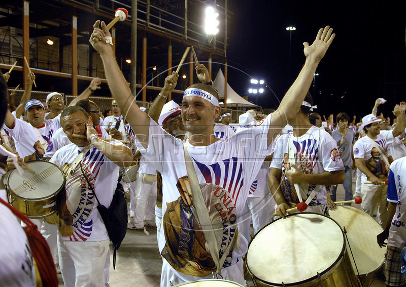 Drummers performs at the Sambadrome during a Uniao da Ilha samba school rehearsal, Rio de Janeiro, February 12, 2011. Uniao da Ilha is one of the 3 samba school damaged by fire in Samba City (Cidade do Samba) in past february 7.  All week end of January and February the Rio's samba schools train in the Sambadrome for the carnival parade. The 2011 carnival start officially March 4. (Austral Foto/Renzo Gostoli)