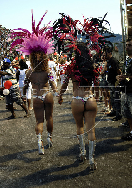 Two samba dancers prepare to perform at a samba school's rehearsal at the Sambadrome, Rio de Janeiro, January 23, 2011. All week end of January and February the Rio's samba schools train in the Sambadrome for the carnival parade. The 2011 carnival start officially March 4. (Austral Foto/Renzo Gostoli)