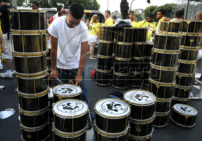 A drummer prepares to participate at Sao Clemente samba school's rehearsal at the Sambadrome, Rio de Janeiro, February 12, 2011. All week end of January and February the Rio's samba schools train in the Sambadrome for the carnival parade. The 2011 carnival start officially March 4. (Austral Foto/Renzo Gostoli)