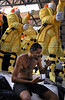 A worker lunches near a float of Sao Clemente samba school, Rio de Janeiro, Brazil, February 12, 2009. The float will be used during the carnival parades which begin on February 21, 2009. Thousands of people work for 6 months out of the year preparing for carnival. (Austral Foto/Renzo Gostoli)