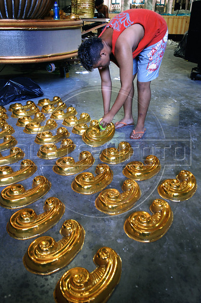 Jonathan Moreira, 18, prepares ornaments for a float of Sao Clemente samba school, Rio de Janeiro, Brazil, February 9, 2011. The float will be used during the carnival parades which begin on March 4, 2011. Thousands of people work for more 6 months out of the year preparing for carnival. (Austral Foto/Renzo Gostoli)